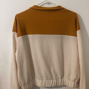 white and burnt orange cropped zipped pullover